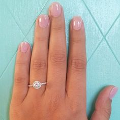 Real-Girl Engagement Ring With a Captivating Cushion Diamond Setting
