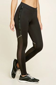 "A pair of knit athletic leggings featuring a side seam ""Get Moving"" continuous graphic, back mesh panels, a contrasting back metallic stripe, and moisture management."