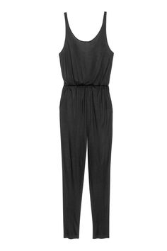 Black. Sleeveless jumpsuit in jersey with a low-cut neckline at back. Elasticized seam at waist, side pockets, and tapered legs.