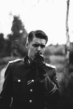 "CAVEAT: I have the strong suspicion that this is either a frame from a movie or some other modern re-enactment, but I can't identify it. It's just too sharp, posed, and ""cool"" looking for a genuine wartime image. It may be one of those Hugo Boss SS uniform designer parodies."