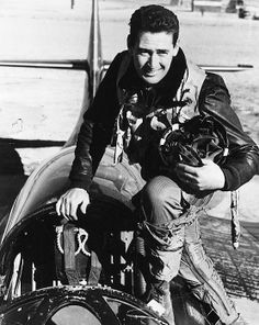 TED WILLIAMS (1918-2002). American baseball player. Photographed in the cockpit of a Grumman F9F-6 Panther fighter plane, while a pilot for the U.S. Marine Corps during World War II, c1943.