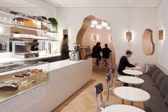 with high ceilings, white walls in a striated finish, and handwritten messages on the walls, this cafe ensures their gluten-free message is heard loud and clear.