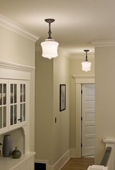 Absolutely love built ins...and great choice for hall lighting