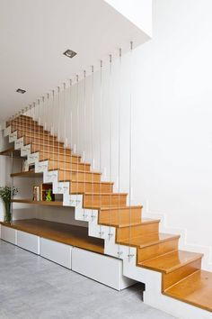 in ho chi minh city, architecture firm MM++ architects has built a narrow multi-storey house on an irregularly shaped plot of land. Stair Railing Design, Home Stairs Design, Stair Decor, Interior Stairs, Modern House Design, Home Interior Design, Railings, House Staircase, Modern Stairs