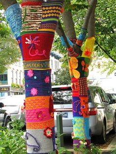 Trees yarn bombed in Bloomington IN, with proceeds going to MiddleWay House Domestic Violence Shelter for women.