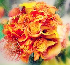 roses, Calla lilies, and Gerber daisies