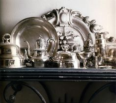 Hang white shelves and display Silver Tea Collection etc.  With hooks at the bottom can hang the Tea Tray.