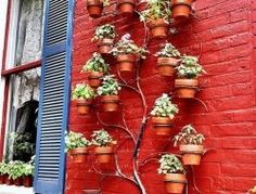 Vertical Garden Trellis made with painted timber offcuts to look like tall daisies. Design doubles as garden art and a practical vertical frame for climbers. More vertical garden ideas @ themicrogardener.... | The Micro Gardener