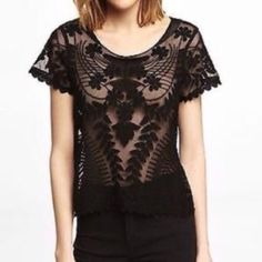 ON SALEExpress Black Lace Tee NWOT. Brand new, super stylish sheer lace top. 100% nylon body, 100% cotton decoration. Express Tops