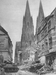 US medium tanks of the 3rd Armored Division advance cautiously around the Cologne Cathedral; Cologne, Germany - March 1945