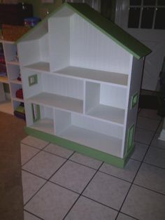 Here is a DIY one - maybe Bumpa can make it for her!  http://ana-white.com/2011/04/dollhouse-bookcase