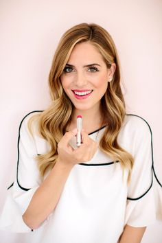 If you're looking for a way to get out of your red lipstick rut, why not try a pink lip instead? The color is fresh for the season, and comes in shades that range from pale to über-bright, so you are guaranteed to find one that suits both your style and skin tone. Julia of the blog Gal Meets Glam has us coveting a bold pink that's perfect for a summer wedding, brunch, or other festive get together.