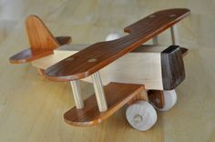 The wings are cherry and the body is maple. There is some oak and walnut in there as well.