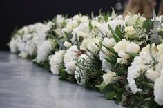 A long, low table display created by students at the McQueens Flower School in London.
