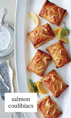 Individual portions of salmon coulibiac—a take on a classic Russian dish of puff pastry enveloping poached salmon, mushrooms, and rice—are easier to serve than a single large coulibiac. Butter Puff Pastry, Traditional Easter Desserts, Russian Dishes, Russian Recipes, Poached Salmon, Dill Sauce, Fish And Seafood, Sour Cream, Recipes