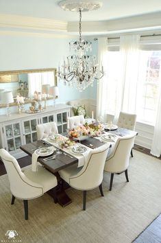 blue dining room and crystal chandelier