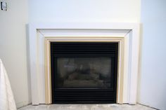 How To Make An Outdated Fireplace Insert Look Like A Million Bucks - Chris Loves Julia Stone Fireplace Makeover, Wooden Fireplace, Paint Fireplace, Home Fireplace, Fireplace Remodel, Fireplace Inserts, Fireplace Surrounds, Fireplace Design, Fireplace Mantels