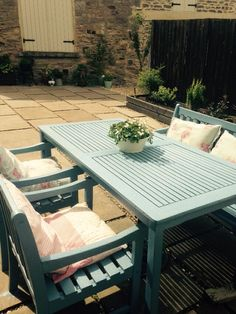 garden table and chairs painted using cuprinol primrose shabby chic cushions