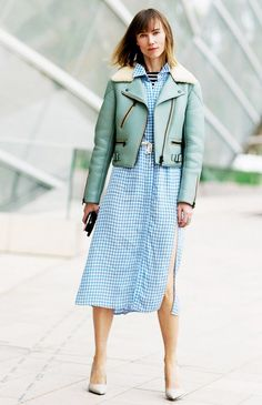 Anya Ziourova wears a gingham midi dress with a turquoise leather bomber jacket and neutral pumps