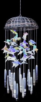 This is so sweet- pick up plastic dolphins and other fish to take the place on top of the tubular shells...