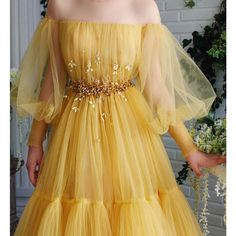 Charming Ella Gown - Details – Yellow bumblebee dress color – Tulle dress fabric – Embroidered crystal and leaves on waist – A-line gown with long sleeves and waist definition – For special occasions Source by shannonnatsu - Prom Dresses Long With Sleeves, A Line Prom Dresses, Evening Dresses, Yellow Prom Dresses, Wedding Dresses, Gowns With Sleeves, Bridesmaid Dresses, Beaded Prom Dress, Tulle Dress