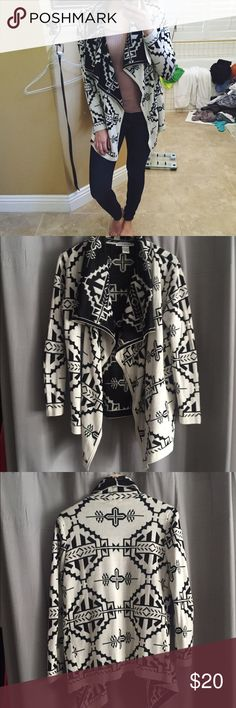 Aztec cardigan sweater Cream and black Aztec/tribal waterfall cardigan sweater. Thick and warm. Perfect for fall and winter. Size medium. Light pulling on sleeves Sweaters