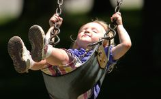 Ah, the bliss of a swing in summer. Photo by Robert K. Yosay. #children