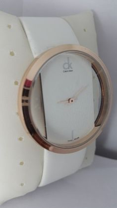 af2f98c3732e8e Calvin Klein White Leather Swiss Quartz Watch with Golden Dial  www.fashiongroop.com