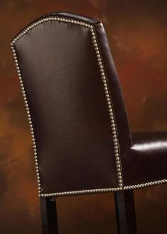 Nailhead trim works well on barstools. The Rushmore Bar Stool has nails around its curved back and seat. Leather Bar Stools, Parsons Chairs, Wing Chair, Nailhead Trim, Dining Chairs, Nails, Stuff To Buy, Inspiration, Design