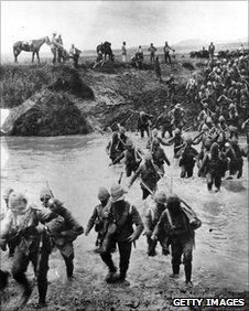 British soldiers cross a river during the Boer War circa 1900
