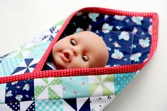 Come learn how to make this Baby Doll Pouch Blanket Tutorial by Lindsay Wilkes from The Cottage Mama. The perfect gift idea for your little one!