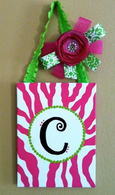 . Each design and letter is hand-painted with acrylic paint and finished with a clear coat to give it a shiny look. They can hang on the wall in your home or outside near your front door. The bow on the top is handmade with ribbon, and finished with a decorative bow.