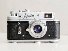 Zorki 4 - functional vintage soviet 35mm film rangefinder camera for lomography with collapsible Fed Industar 10 lens 50mm f:3.5 and strap
