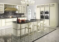 Stone worktop and backsplash add perfect contrast to the elegant kitchen ambiance Kelly: Chic Modern Kitchen Wrapped in Intricate, Timeless Panache
