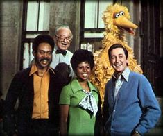 original cast--Sesame Street I can still remember their names! Gordon, Susan, Bob, Mr Hooper and of course, Big Bird. :)