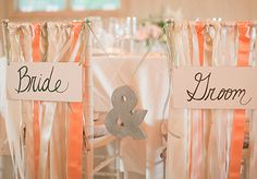 Bride and Groom Chair Decor. I like the ribbon with the signs