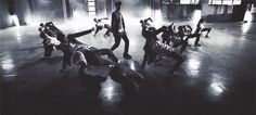 "I never noticed how Chanyeol was ""controlling"" EXO in growl... (gif) which is really fuckin cool"