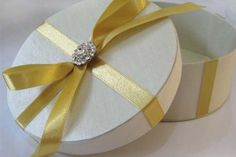 Embellished Cylinder Shaped Ivory Silk Gift Box With Bow & Crystal Button Embellishment - Handbag-Asia.com | Luxury Invitations, Hand-Made Stationary, Packaging & Bags