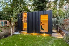 Charred cedar clads this garden yoga studio and office by Neil Dusheiko in north London