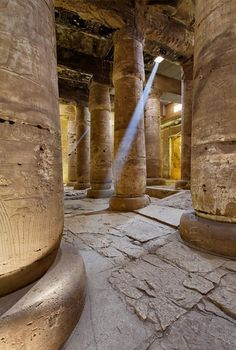 'Second Hypostyle Hall of Seti I Temple at Abydos.'    	A sun beam piercing through a a hole in the roof illuminates the Seco...