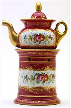 Porcelain Veilleuse Theieres (1750-1860):  Maroon dominates the coloring of this conventional pot and base, with gold and white floral nosegays.