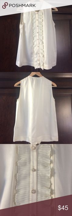 Joie Ruffle Blouse Joie cream colored, sleeveless, ruffle blouse. Beautiful buttons. Dress up with a cardigan or blazer or wear alone. Freshly dry cleaned and ready to be worn! 100% silk. Joie Tops Blouses