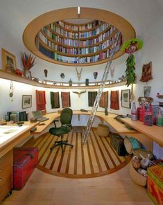 Bookshelves above work space. (The office of National Geographic's Wade Davis designed by Travis Price.)