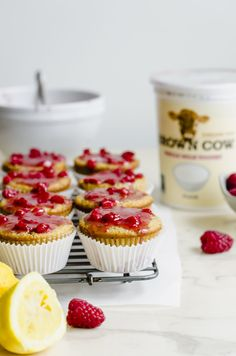 #AD This recipe for Lemon Poppyseed Muffins with Fresh Raspberry Glaze uses Brown Cow cream top yogurt to make a moist and light muffin batter. These make for the perfect treat to take to a neighbor, friend or coworker to show that you care! #lemonpoppyseedmuffins #creamtopyogurt #springrecipes