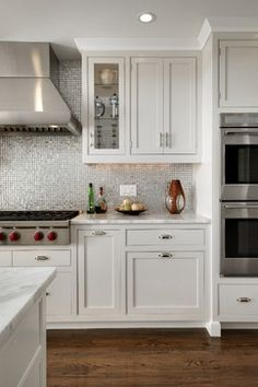Cabinet color, crisp white molding at top, backsplash and counters...simple, subtle and beautiful.
