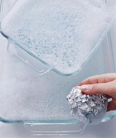 Wad a clean piece of foil into a ball, then use it with few drops of dishwashing liquid to scrub glass cookware clean.