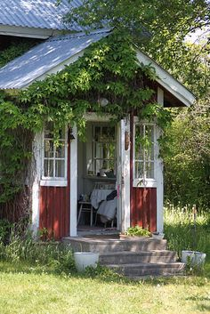 "The dream summer cottage house in red and white. Somehow this makes me think of what I'd imagine bringing to the downstairs. Now, how to accomplish that ""feeling"" in a ""look"" in that room."