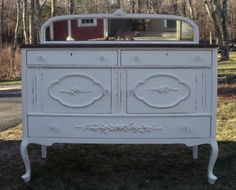 1930s sideboard with a pretty mirror....we have added pretty rose garlands and crystal knobs to make her so Shabbylishious!