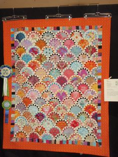 """""""Happy Clams"""" by Anna Macaluso began as a friendship group fabric swap. She made this quilt from the 120 pieces (size 7 by 9 inches) which she received. """"Happy Clams"""" earned a blue ribbon and """"Best Use of Color"""" prize."""