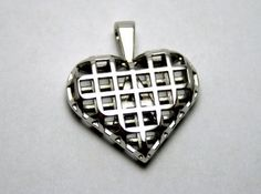 A unique pendant, available in different precious and semi precious materials, with a letter of your choice inside the heart!